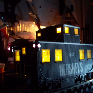 caboose, lighted by track power.